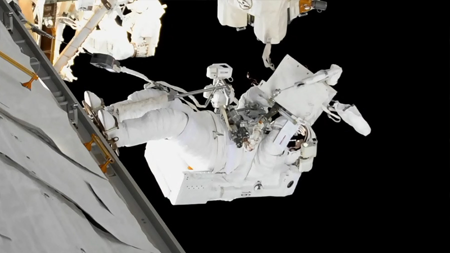 Mark Vande Hei works to lubricate the end effector of the robotic  Canadarm2  during U.S. EVA-45. Credit: NASA
