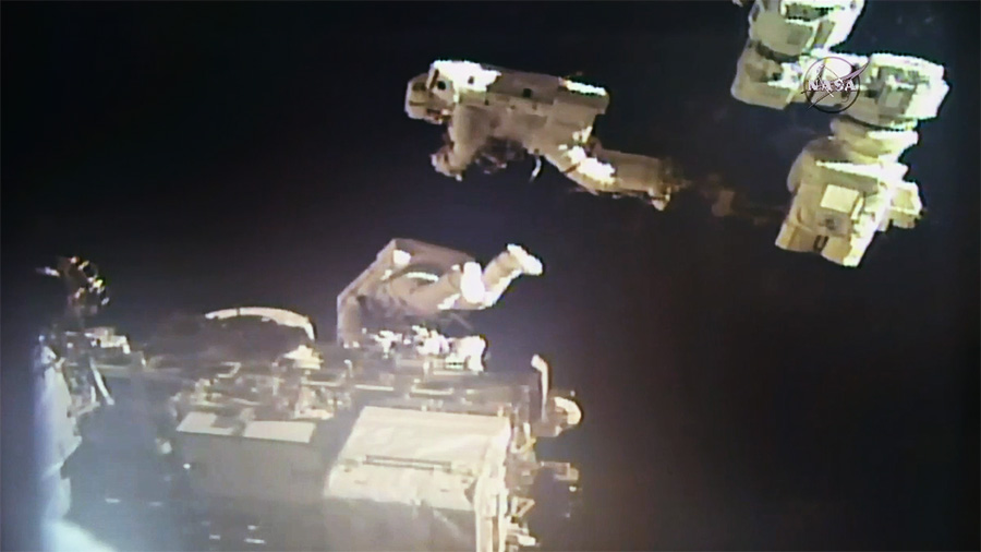 NASA astronaut Mark Vande Hei, upper right, and Japanese astronaut Norishige Kanai tag-teamed to reshuffle the locations of the old latching end effectors. Credit: NASA