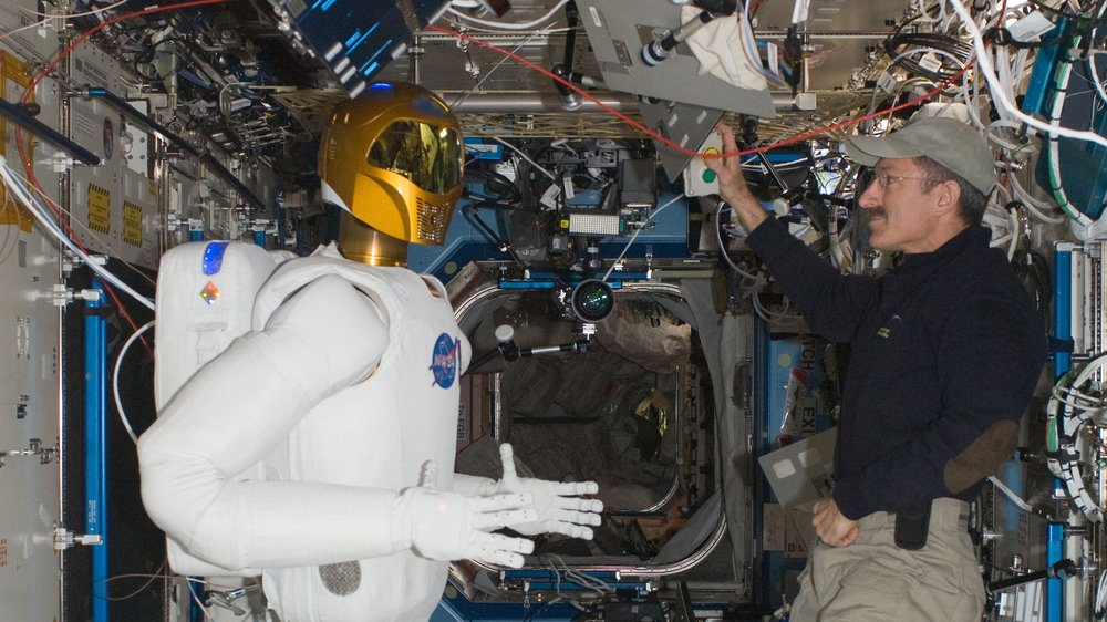 Expedition 30 commander Dan Burbank checks out Robonaut2 in February 2012. Credit: NASA