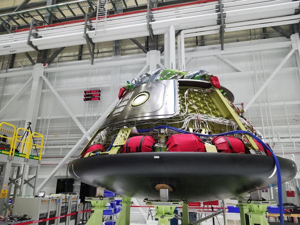 On March 15, 2018, Boeing engineers installed the base heat shield for Starliner Spacecraft 1 at the company's Commercial Crew and Cargo Processing Facility in Florida. This vehicle will be used for a pad abort test at White Sands Missile Range in New Mexico. Credit: Boeing