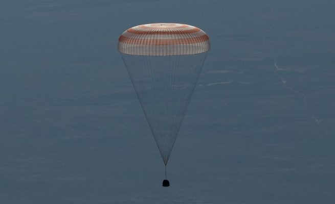 The Soyuz MS-07 spacecraft with Russian cosmonaut Anton Shkaplerov, NASA astronaut Scott Tingle and JAXA astronaut Norishige Kanai descends beneath the capsule's single large parachute. Credit: Bill Ingalls / NASA
