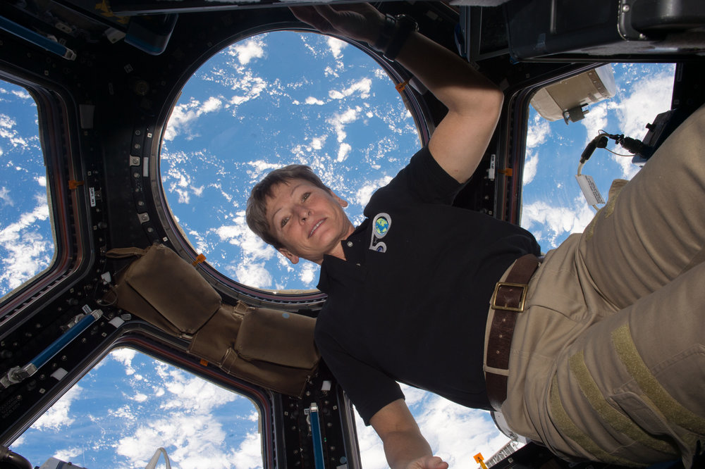 Peggy Whitson floats inside the International Space Station's Cupola window during Expedition 50. Credit: NASA