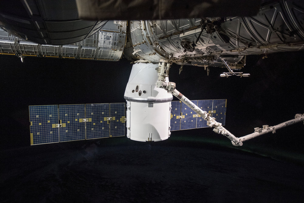 SpaceX's CRS-14 Dragon pictured installed to the Earth-facing port of the Harmony module. Credit: NASA