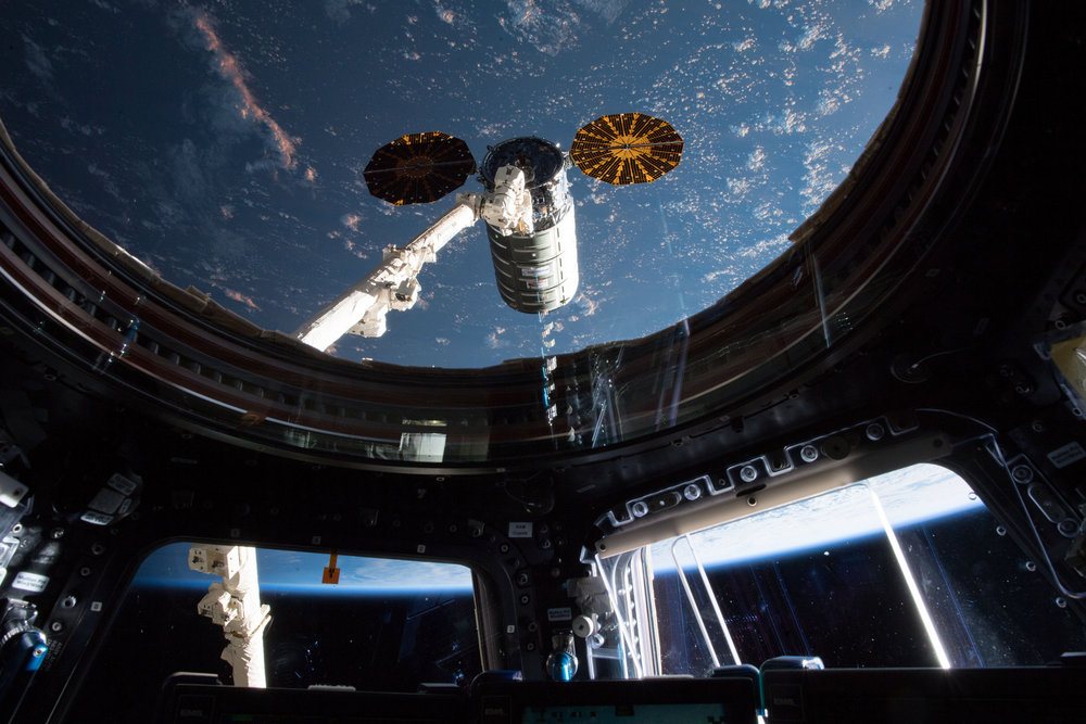 The OA-9 Cygnus spacecraft as seen by the ISS crew inside the station's Cupola window. Credit: NASA