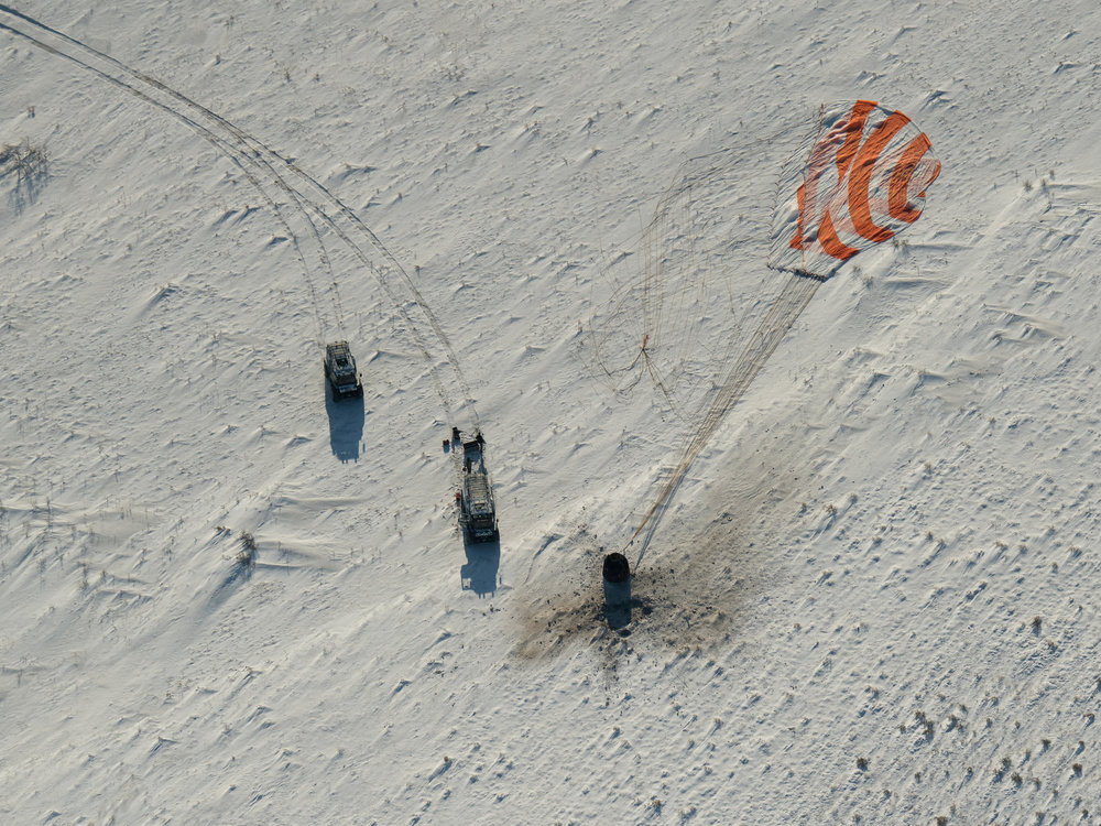 Search and recovery teams arrive at the landing site of Soyuz MS-05. Credit: NASA/Bill Ingalls