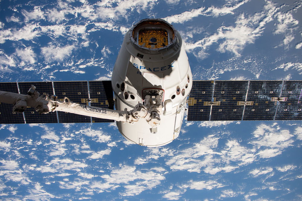 The CRS-11 Dragon is captured by the robotic Canadarm2 on June 5, 2017. Credit: NASA