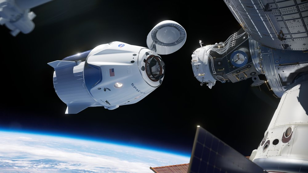 An artist's rendering of a SpaceX Crew Dragon near International Docking Port 2 at the forward part of the International Space Station. Credit: SpaceX