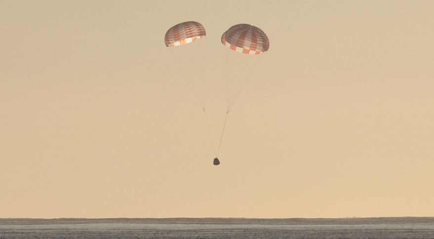 File photo of a Dragon cargo spacecraft descending toward the Pacific Ocean under its three main parachutes. Credit: SpaceX