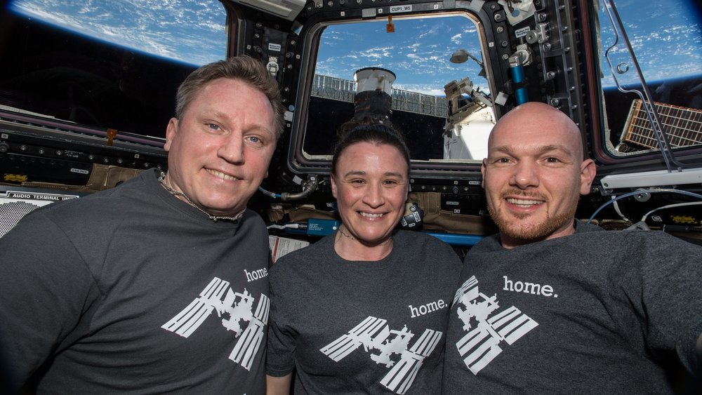 Russian cosmonaut Sergey Prokopyev, left, NASA astronaut Serena Aunon-Chancellor, center, and European Space Agency astronaut Alexander Gerst pose for a crew photo in the space station's cupola window. Credit: NASA