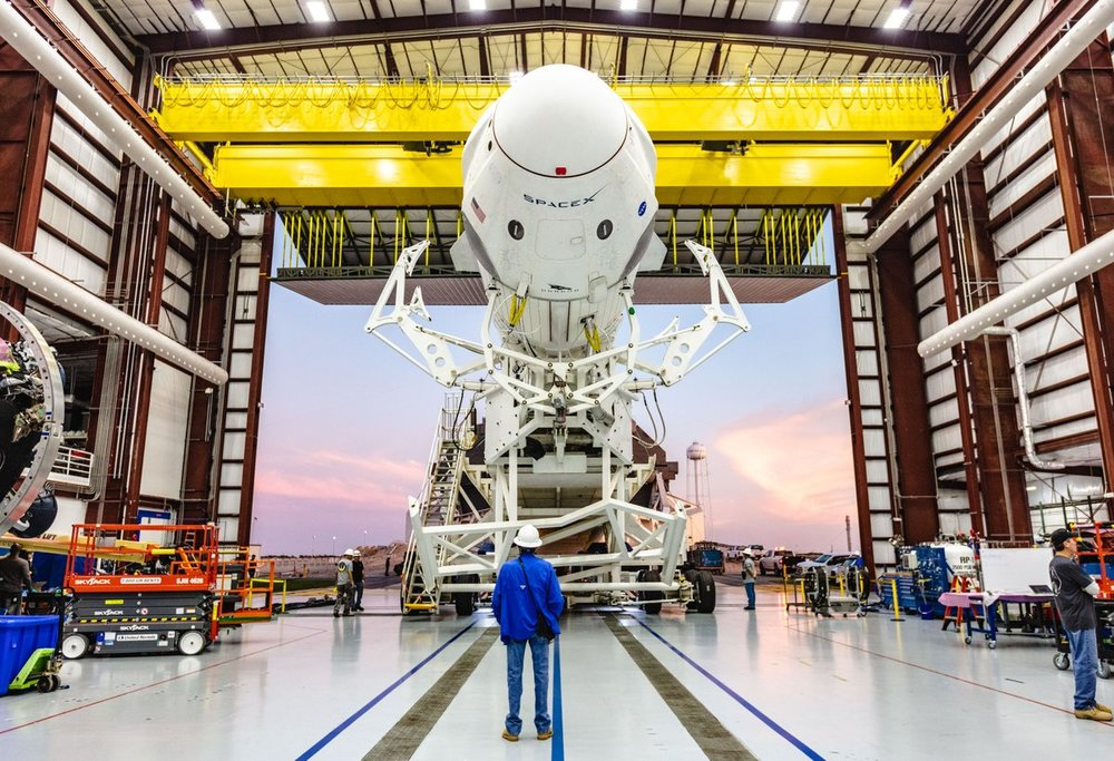 SpaceX engineers prepare to roll a Falcon 9 with Crew Dragon to Launch Complex 39A. Photo Credit: SpaceX