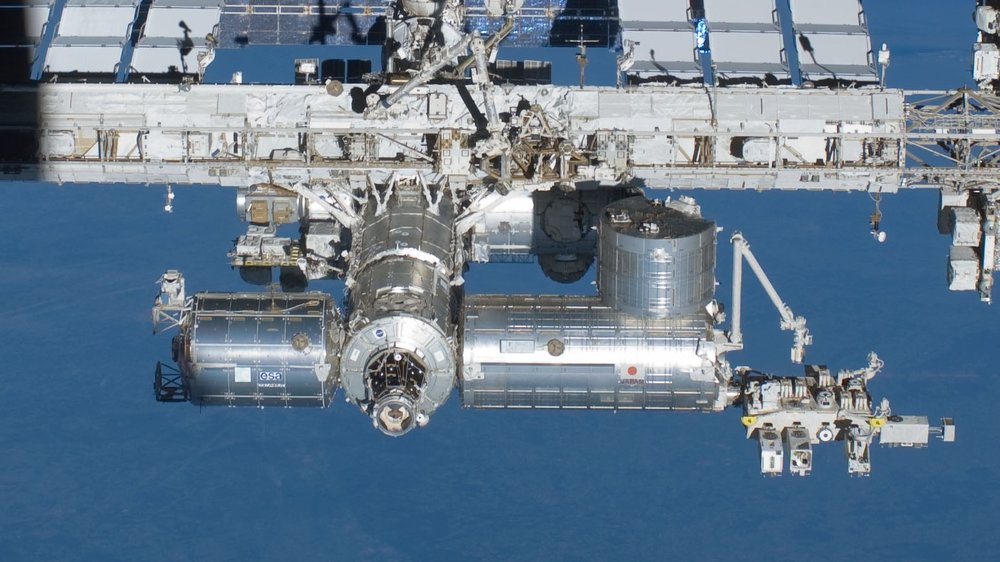 """The European Space Agency's Columbus module, lower left, has been in space for more than 10 years and has sustained """"hundreds"""" of impacts. Credit: NASA"""