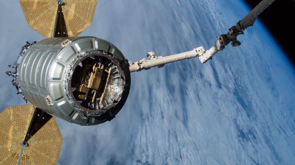 """The NG-10 Cygnus was unberthed and released from the International Space Station on Feb. 8, 2019. Since then it performed a post-ISS mission to deploy several CubeSats, including some via a """"SlingShot"""" deployer, seen here attached to the spacecraft's hatch. Credit: NASA"""