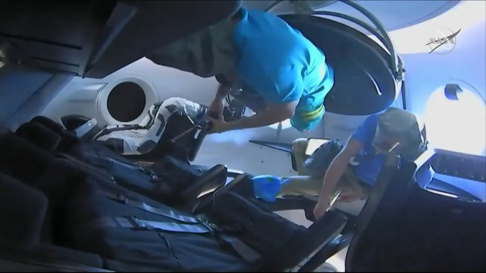 David Saint-Jacques and Oleg Kononenko were the first two people inside the Crew Dragon following hatch opening. Credit: NASA