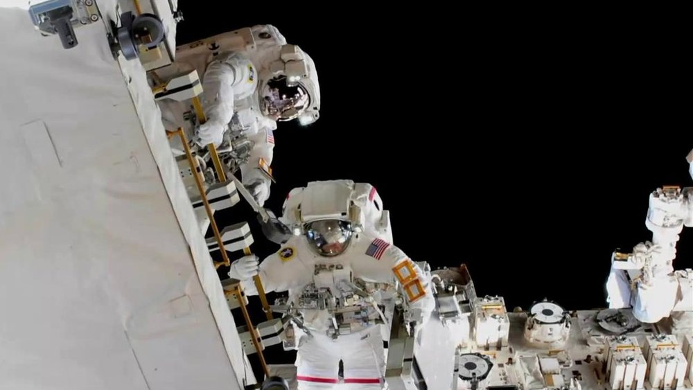 NASA astronauts Anne McClain, bottom, and Nick Hague work to install new lithium-ion batteries on the P4 truss segment. Credit: NASA