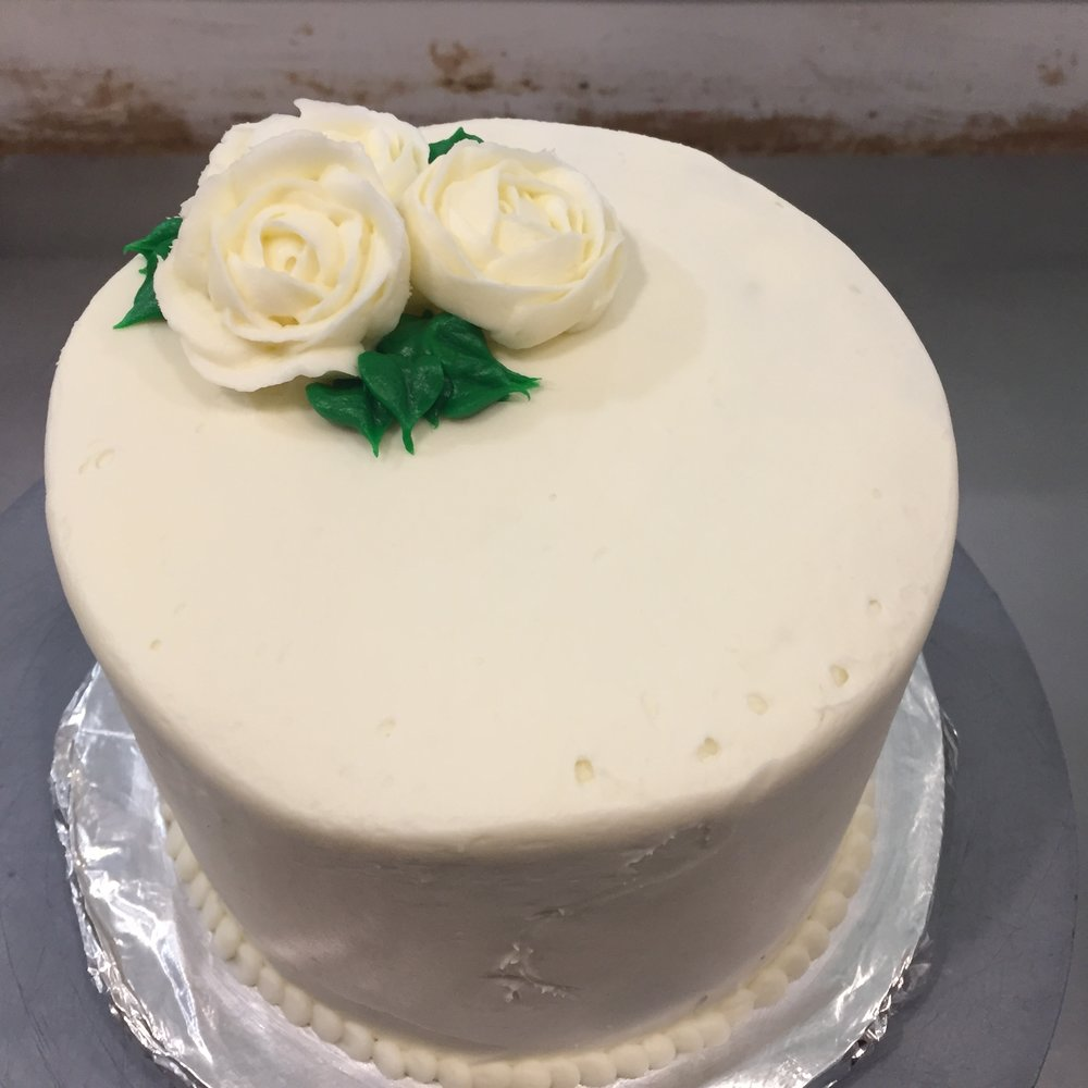 "6"" full tiered white rose cake"