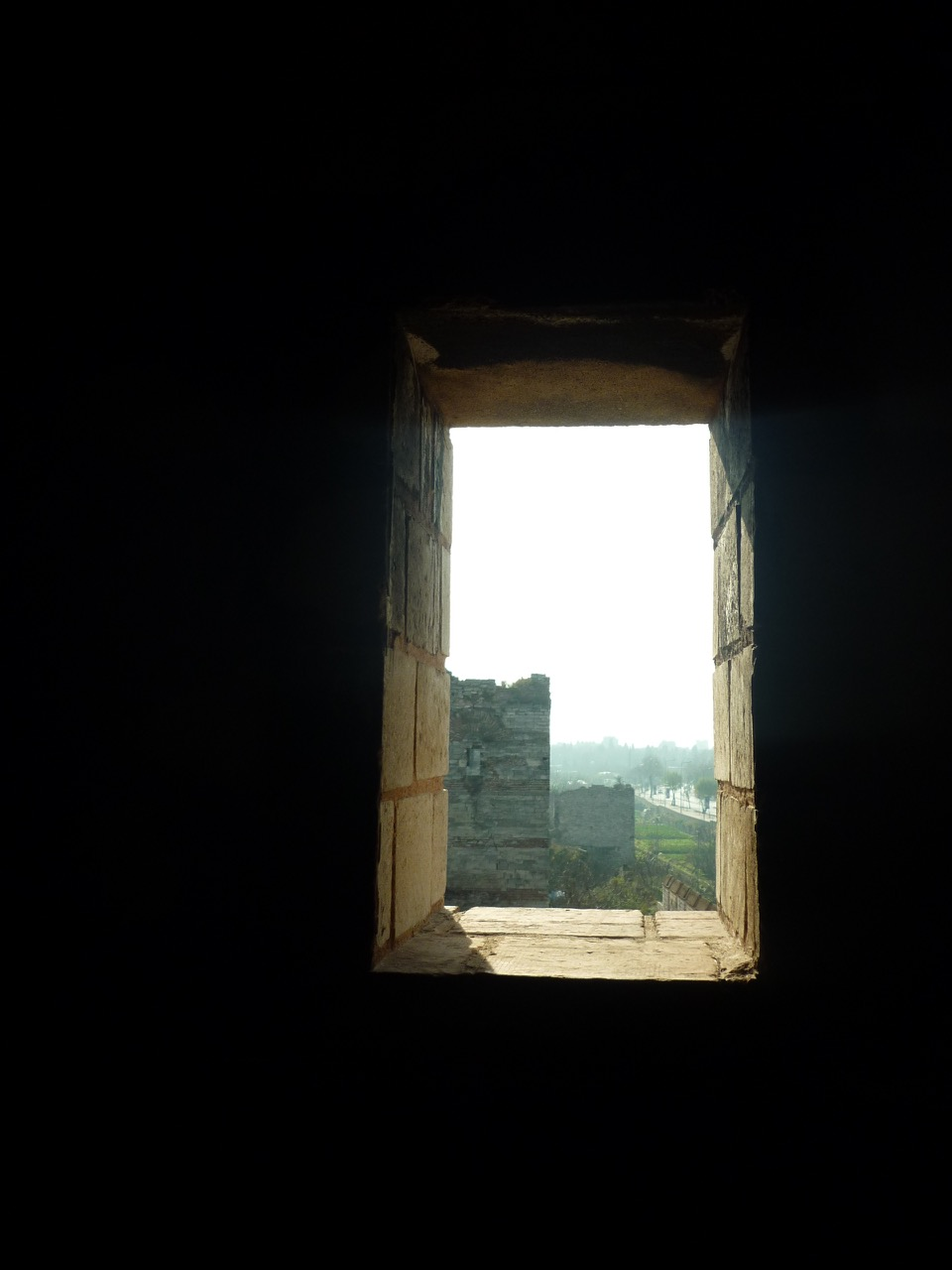 View of the legendary Theodosian Walls of Constantinople through a turret window (photo by the author).
