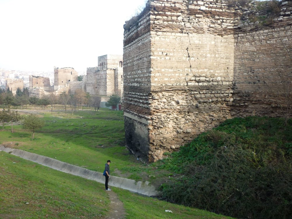 A stretch of the Theodosian Walls, near the Charisian Gate. Only the high inner wall still stands; the outer wall was shattered by the cannons of the Ottoman Turks in the final siege of 1453 (photo by the author)..