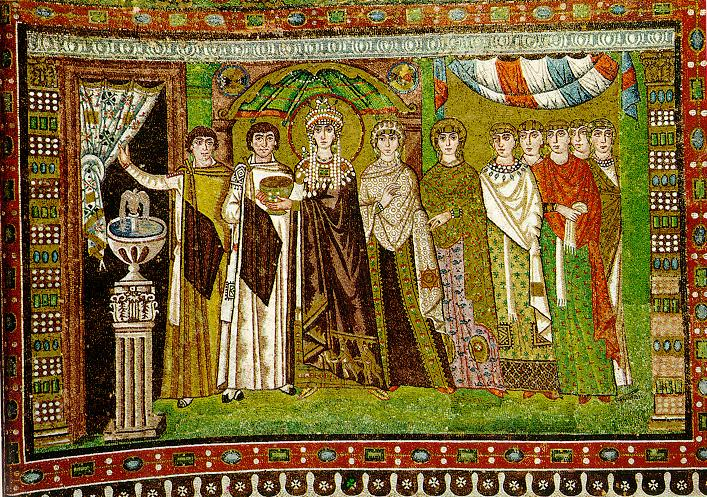 Complementary mosaic of Empress Theodora with her attendants, which faces her husband's mosaic in San Vitale. The empress carries the chalice for the communion wine. Justinian bears the basket for the bread (wikimedia commons).