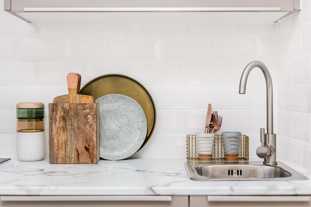 TIP: Use everyday items as decorative pieces on your countertops