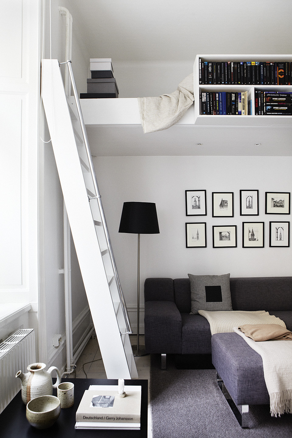 TIP:  A bed on a raised platform can also add storage to a small space. (Photo: Fantastic Frank Design)