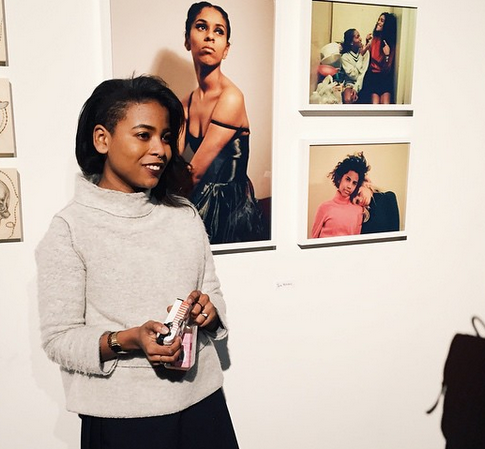 Tyra with her photos at the Girl Artist Takeover show in Brooklyn, 2015