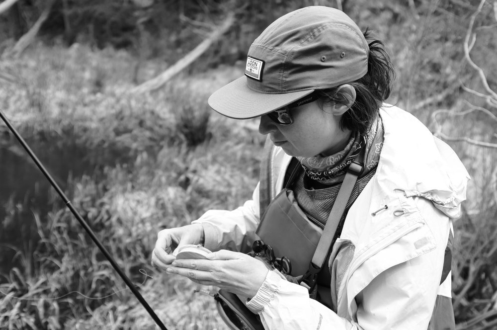 Dana unspools her level line near a promising pond.