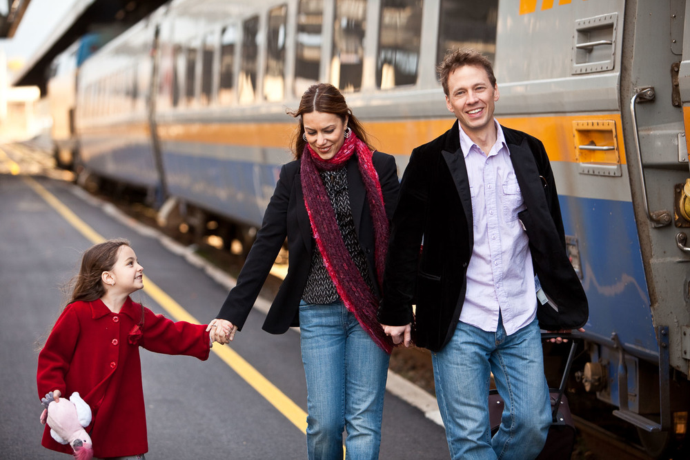 Portrait of a family next to a train
