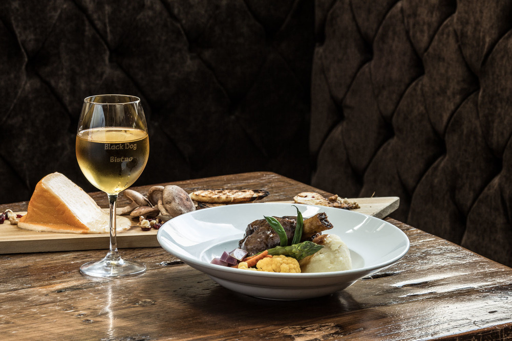 Photograph of food and wine