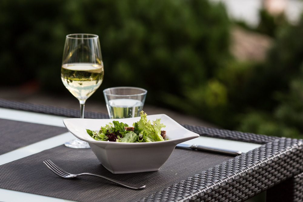 Photograph of food and white wine