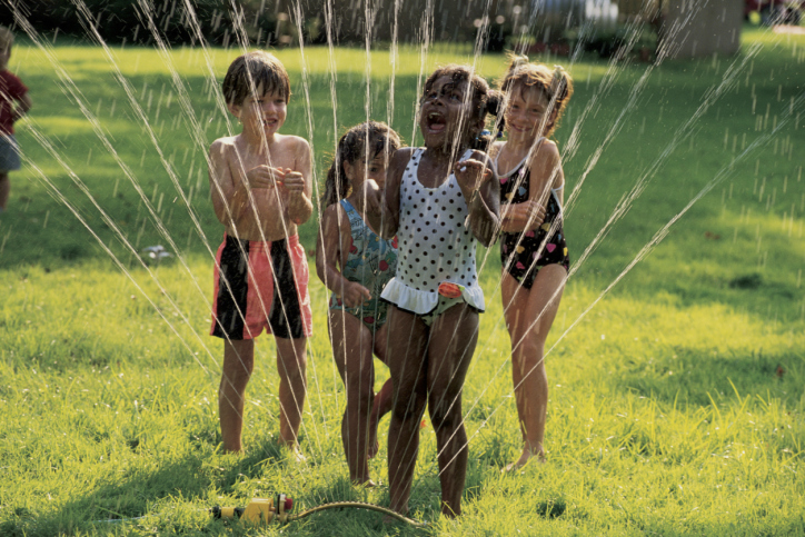 kids-running-through-sprinkler