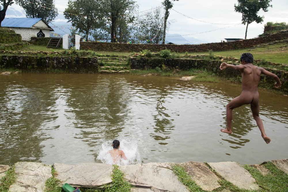 Nepal, 2015. Local kids bare it all and jump into a small pond in Kala Bang to swim on a sunny afternoon. Image by Pankaj Khadka.
