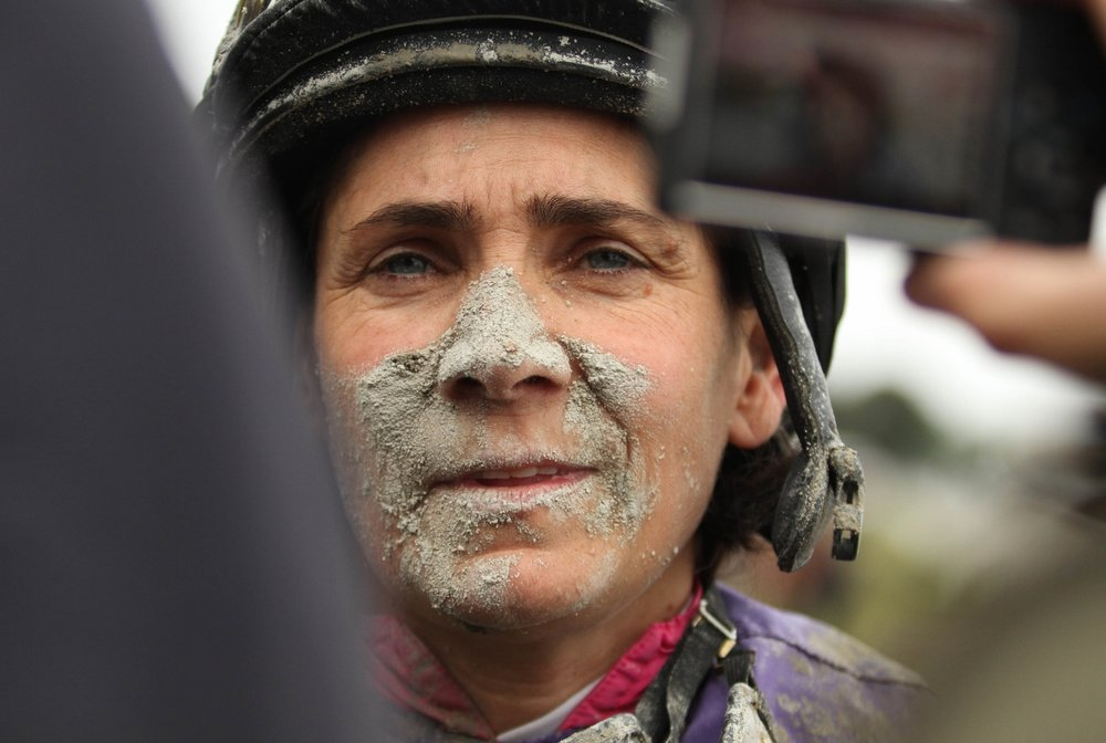East Boston, MA. Oct. 4, 2014. A female jockey is interviewed by media after she wins one of the eight races on the lsat race day of the Suffolk Downs Racetrack. Photo by Pankaj Khadka