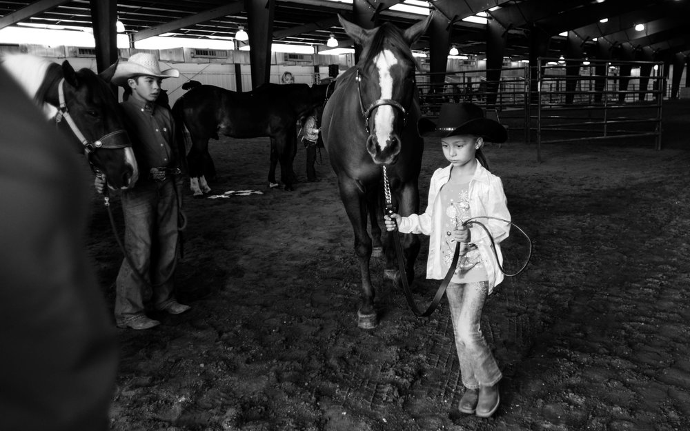 A girl brings out her horse during a horse show competition at a rodeo in Southeastern Colorado. Photo by Pankaj Khadka