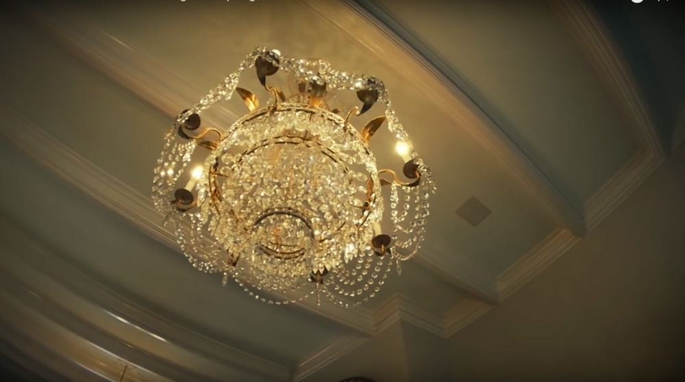 A pair of these original chandeliers hang in the great room.