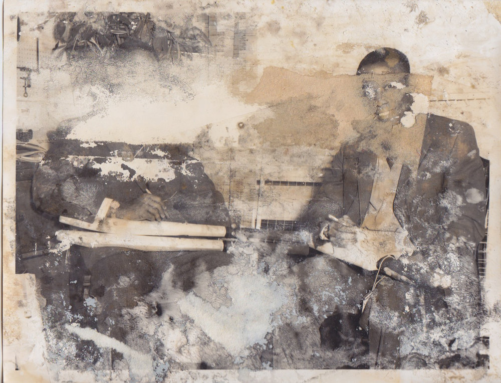 Flood damaged photo of unnamed West Indian Cricketers signing bats in 1964. No location given. From the personal collection of John Gasson, Master Bat Maker for Gray Nicolls Cricket.