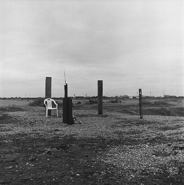 Dungeness (2012) - C. King I have been going through some recent negs. This is a quick scan from a film I took in early winter of last year. The posts mark the crash site of a Polish Spitfire Pilot based in Kent in WW2.