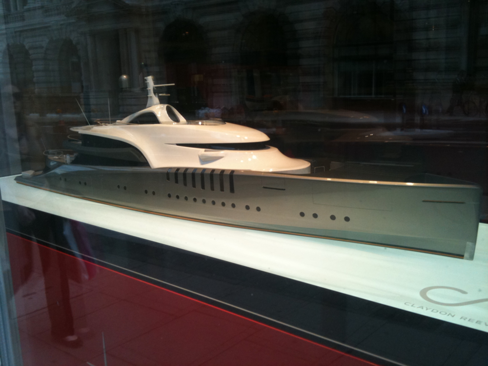 Saw this model in a shop window on St James St, a shop that sells super-yachts, not model ones, real ones, like the ones only really vulgar Russian Oligarchs & Arab Sultans can afford. For me, traditional model yachts have always had an idle dream quality about them, ideas of escape from the everyday routine, but this thing, like so much in our age of aspirational greed just reeks of wealth rather than a dream of the sea.