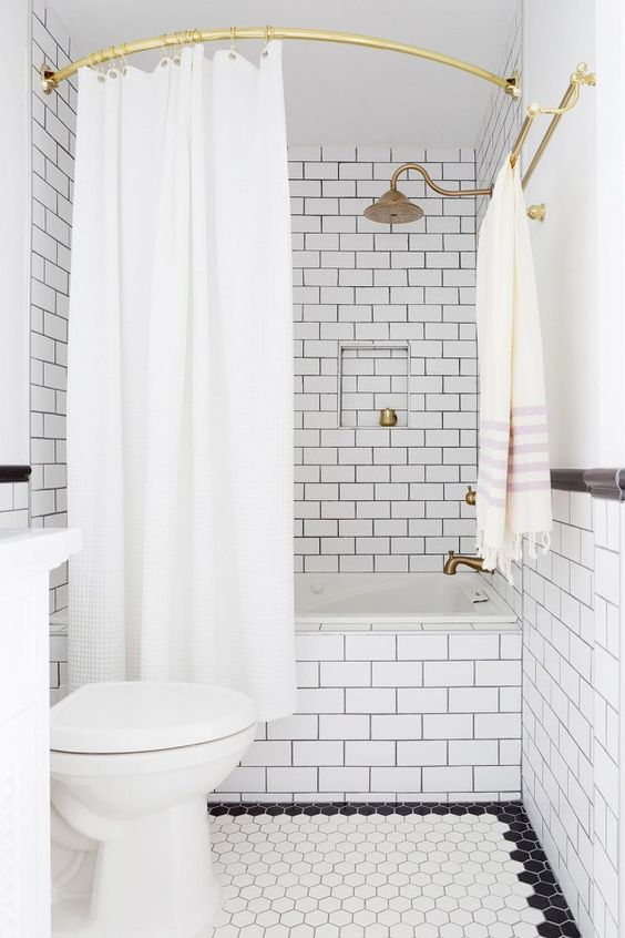 Traditional Bathroom Looks Modern With Curved Rod