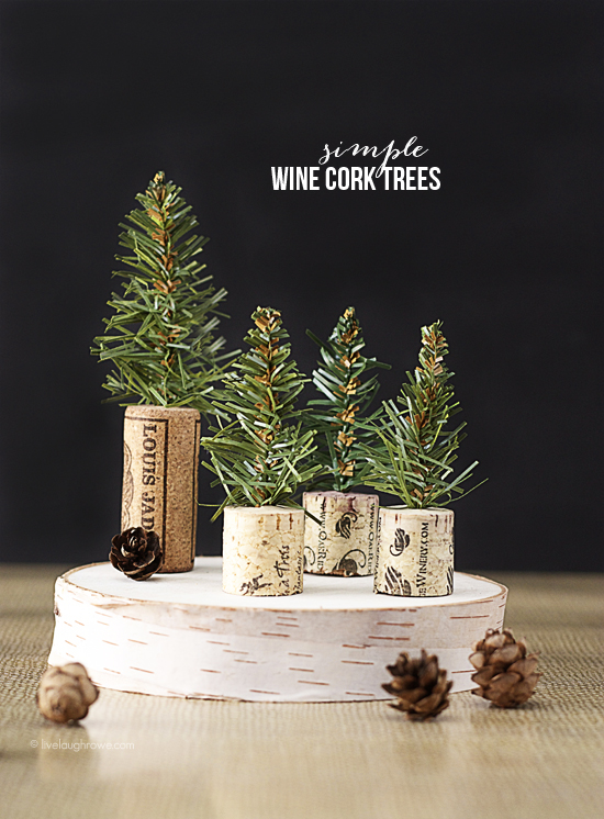 Little Tree Corks  - Use old wine corks and branches to create little Xmas Trees.