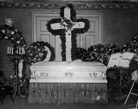 Gus Winkler 's floral adorned casket