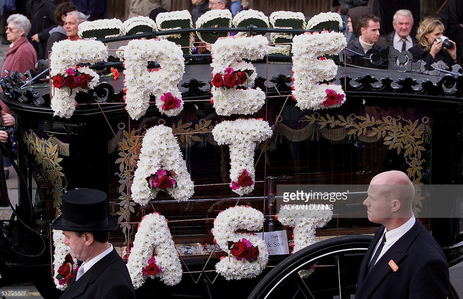 "Reggie Kray 's hearse was covered with flowers spelling ""Free At Last"""