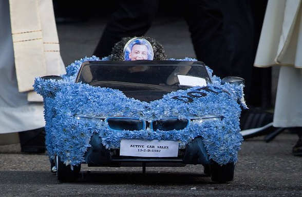 David Byrne 's funeral procession included a remote control car adorned in blue flowers