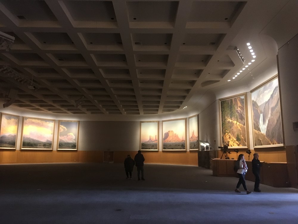 """Here are some of the 5 triptychs paintings by artist Wilson Hurley titled """"Windows to the West"""" If you can fathom the size of these paintings, they are 16' high by 32' wide! The large room here is for conferences and banquets."""