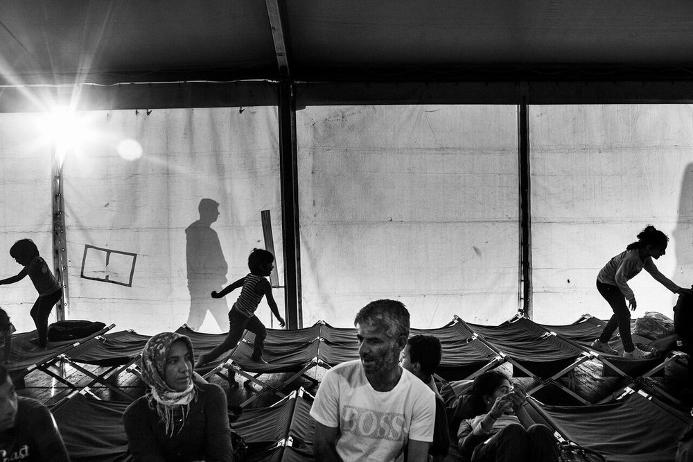 Augusta, Italy - Syrian refugee children play in the reception tent at the dock of the Sicilian port of Augusta, Italy after having been registered by the Italian authorities. They left from Mersin, Turkey and spent five days at sea without food or water before being rescued by the Belgian navy. The number of refugees and migrants taking the dangerous journey across the Mediterranean to Europe, fleeing war, hunger, and persecution, is only increasing.