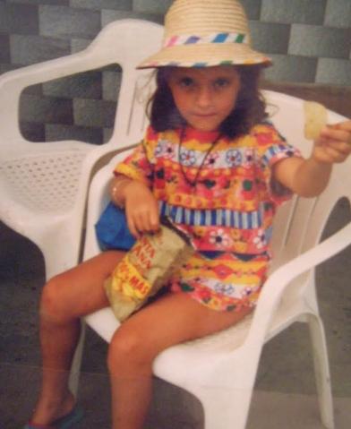 Olaya Barr as a child holding  chuches . Courtesy of Olaya Barr.