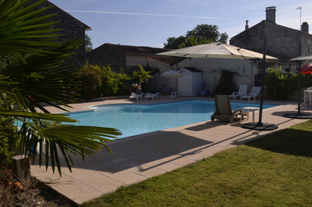 The pool, terraces and lawns