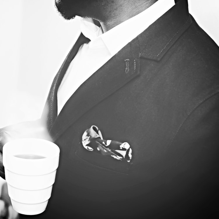 man-suit-white-coffee-cup-min.jpeg