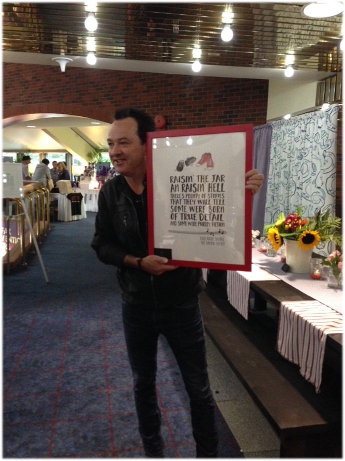 Jimmy Rankin loving his custom made Rankin Family lyrics.  Made by Jill + Jack Paper.