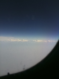 first glimpse of the himalayan range from a dirty window