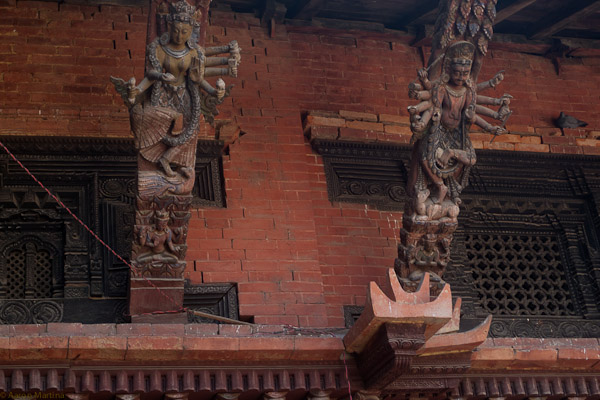 Carvings on supports for the overhang